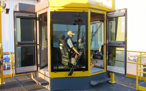 Project Manager Iain Peebles experiences the comfort and visibility of the new cab while tramming the Pit Viper 311 to its display position at the Atlas Copco booth.