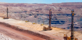 Overview of the massive iron ore mine at Sishen: Pit Viper 351 rigs drill the blastholes while ROC L8 rigs take care of crest drilling at the Sishen mine.