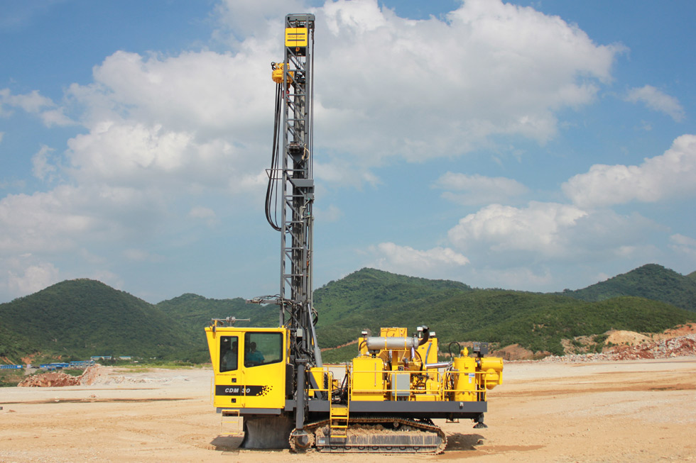One of four DM 30 II rigs in OTCC Jurong's fleet at the Xiguoding Cement mine in the Yangtze River Delta. These are high pressure drills for DTH drilling.