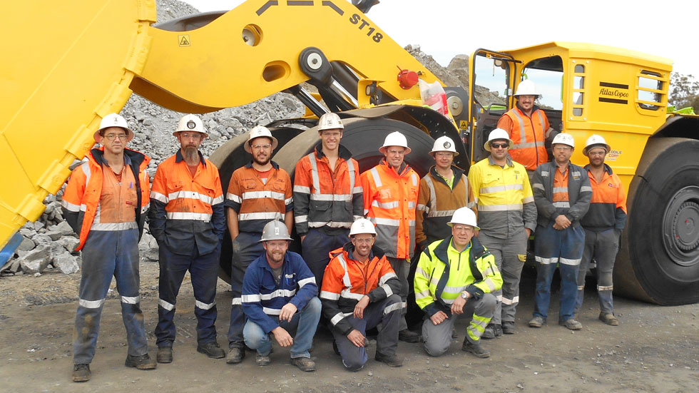 The crew at the Stawell Gold Mine including Atlas Copco technicians and product specialist, proudly pose for a group photo with the new Scooptram ST18.