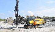 Designed for drilling 64–115 mm holes, this tophammer rig has an extendable boom, a COP 1840 rock drill and Atlas Copco Secoroc's T45 couplings and 89 mm ballistic button bits.