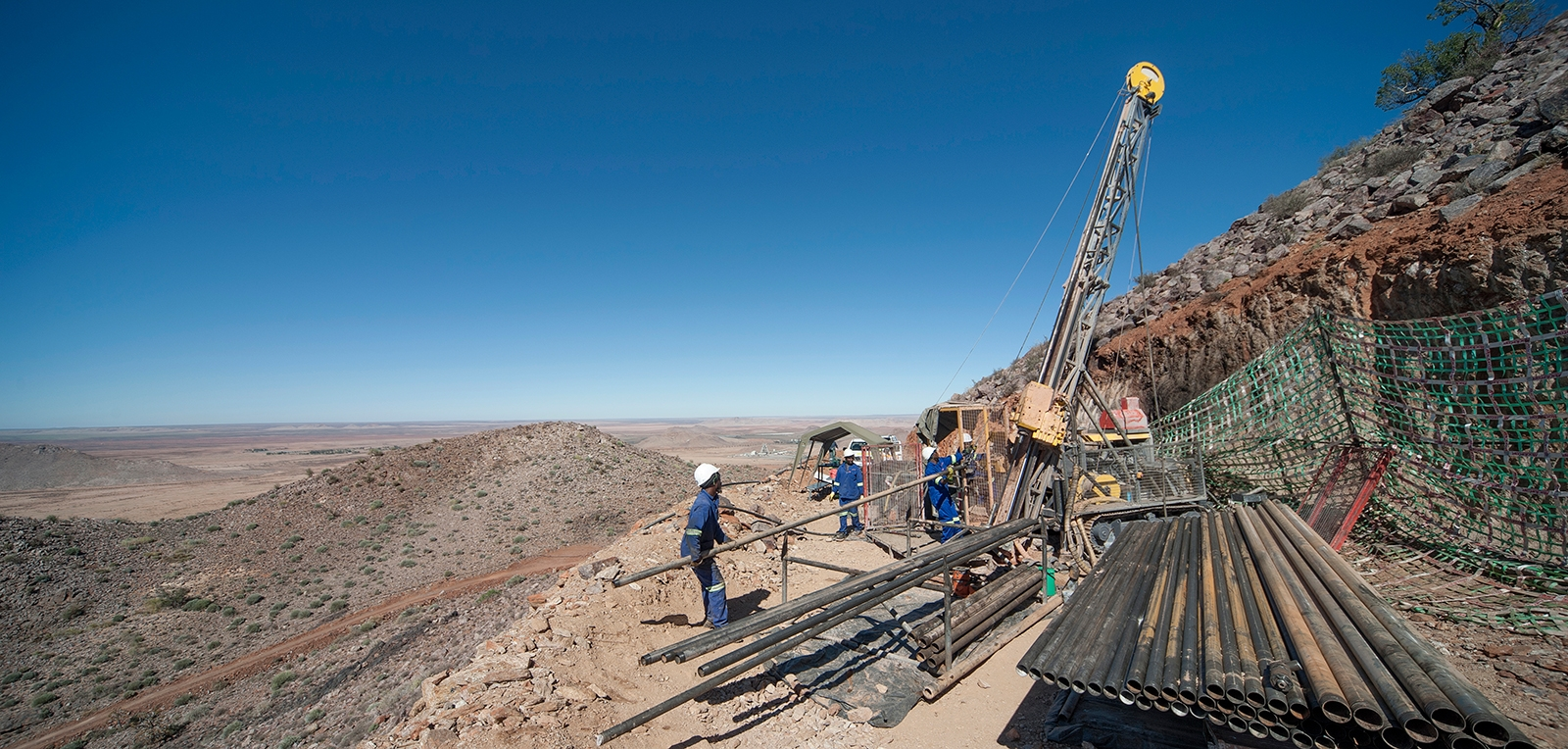 The surface core drilling rig, Boyles C6C from Epiroc, on the mountainside drilling site in Black Mountain.
